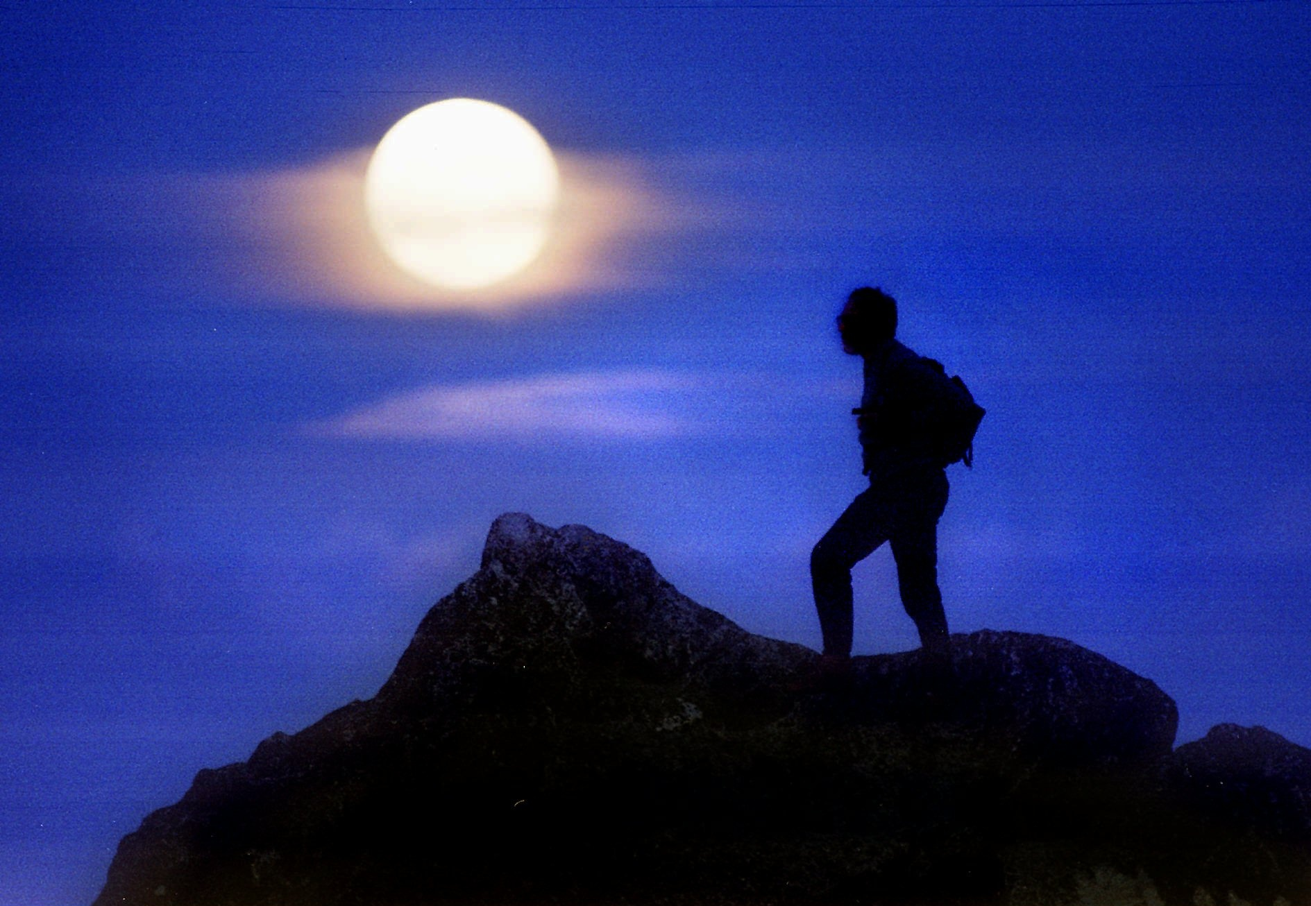 ADVANCE FOR WEEKEND EDITIONS SEPT. 7-8 -- A moonlit hiker crosses a ridge near the summit of Mt. Ashland near Ashland, Ore., in July, 1996, during a full moon. (AP Photo/Mail Tribune, Bob Pennell)